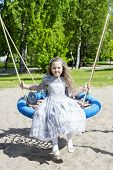 stock photo of polite girl  - Sweet little girl in dress looks directly - JPG