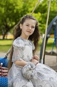 stock photo of polite girl  - A seriously looking graceful sweet little girl - JPG
