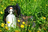 stock photo of canteen  - Hiking boots and a canteen are on a summer meadow - JPG