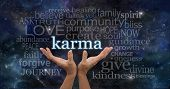 stock photo of karma  - Female hands cupped upwards with the word  - JPG