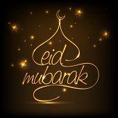 pic of ramadan mubarak  - Golden creative text Eid Mubarak with illustration of mosque on stars decorated brown background - JPG