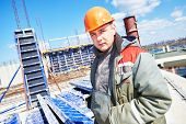 stock photo of millwright  - construction builder worker at building site  - JPG