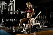 image of fatigue  - fatigued beautiful girl bodybuilder rest post exercise with weight - JPG