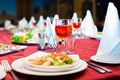stock photo of banquet  - Festively served banquet table with glasses and salads - JPG