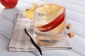 foto of cider apples  - Glass of apple cider with fruits and vanilla stick on table close up - JPG