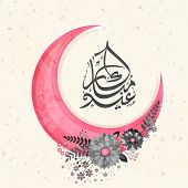 stock photo of eid al adha  - Arabic calligraphy text Eid Mubarak with pink crescent moon and flowers for muslim community festival celebration - JPG