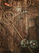 picture of fishing bobber  - Fishing tools on a wooden background - JPG
