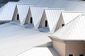 stock photo of roofs  - Unique triangle metal roof designed for maximum rain repulsion - JPG