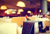 Постер, плакат: Served dinner table in a restaurant Restaurant interior Cozy restaurant table setting Defocused b
