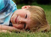 Cute Boy In Grass poster