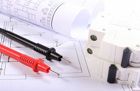 stock photo of electrical engineering  - Cables of multimeter electric fuse and electrical construction drawings of house electrical drawings and tools for engineer jobs - JPG