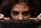 foto of yashmak  - Portrait of witch over dark background - JPG