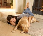Attractive woman with labrador the dog on the flor