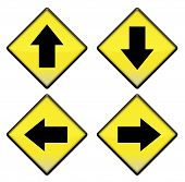 Group Of Four Yellow Road Signs With Arrows