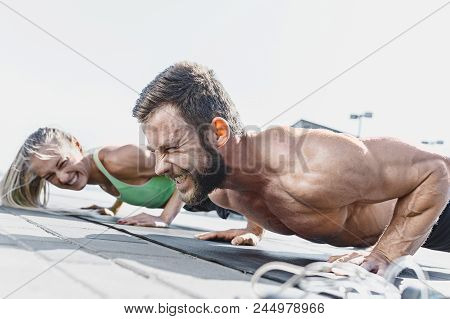 poster of Fit Fitness Woman And Man Doing Fitness Exercises Outdoor At City Background. Couple Doing Hamstring