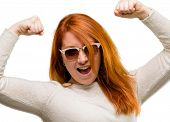 Beautiful young redhead woman happy and excited celebrating victory expressing big success, power, e poster