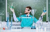 Smart?man scientist making chemical experiments in the laboratory. Educational concept. Discovery.  poster