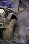 Racing On Off-road Cars. Part Of Suv Stuck In Dirt, Close Up. Dirty Offroad Tire Covered With Mud. W poster