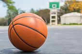 Basketball On Basketball Field On Front View With Copy Space poster