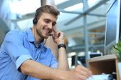 Smiling Friendly Handsome Young Male Call Centre Operator poster