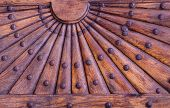 Ornate Wooden Pattern With Metal Rivets. Relief Wooden Part Of Old Door With Geometrical Ornament In poster