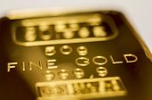 The Surface Of Gold Bullion. The Texture Of The Surface Of The Minted Gold Bar. Selective Focus, Sha poster