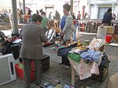 Shoppers Search For Bargains At A Weekly Flea Market