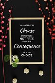 Motivational And Inspirational Quote. Wisdom Quote. Wood Frame With Flowers On Black Background With poster