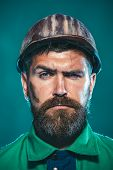 Builder Working With Construction Helmet. Portrait Bearded Man With Protect Helmet Wearing. Business poster