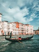 Venetian Gondolier Punts Gondola In Venice, Italy poster