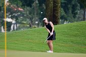 KUALA LUMPUR, MALAYSIA - OCTOBER 16:Paige McKenzie of the USA chips towards the hole at the Sime Dar