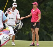 KUALA LUMPUR, MALAYSIA - OCTOBER 16: Paula Creamer of the USA takes the ball from her caddie on day