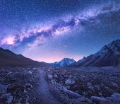Milky Way And Mountains. Space. Amazing View With Mountains And Starry Sky At Night In Nepal. Trail  poster