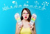 Portrait Of Beautiful Surprised Young Woman With Sandals On The Wonderful Blue Studio Background Wit poster
