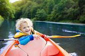 Child On Kayak. Kids On Canoe. Summer Camping. poster