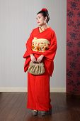 Beautiful Oriental Woman In Red Japanese Kimono