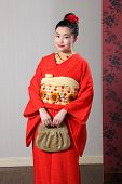 Oriental Woman In Red Traditional Japanese Kimono