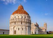 Piazza dei Miracoli known as Piazza del Duomo, famous UNESCO World Heritage Site with the Baptistery poster