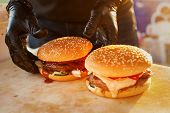 Two Finished Burger On A Wooden Board. Open Kitchen In The Street. Street Fast Food poster