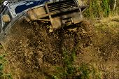 Suv Takes Part In Racing On Fall Nature Background. Automobile Racing, Car Wash And Off Road Vehicle poster