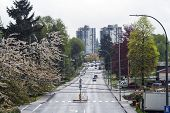 Looking Down The Tree-lined Road On Main Street Of Port Moody, Outside Of Vancouver, Bc On An Overca poster