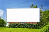 Horizontal Shot Of A Blank Neighorhood Billboard Under A Blue Sky Surrounded By Greenery. poster