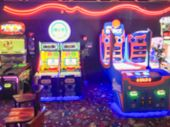 Abstract Blurred Arcade Game Room At Entertainment Complex poster