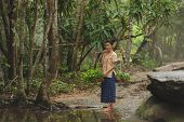 Asian Woman Wearing Traditional Thai Culture At The Forest.daily Life Of Rural Women In Thailand,asi poster