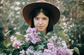 Sensual Portrait Of Beautiful Boho Woman In Hat Holding Lilac Flowers Bouquets In Sunny Spring Park. poster