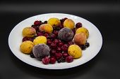 A Berry Mix From Frozen Currant, Apricot, Plum, Cherry On The White Plate. Frozen Berries From Freez poster