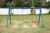 stock photo of swingset  - the swing set on the playground  - JPG