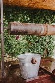 Old Water Well In The Garden. Draw Well In European Village. Country Side Lifestyle poster