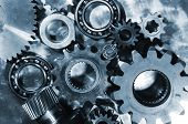gears, cogs and bearings, engineering parts in a deep blue duplex toning concept