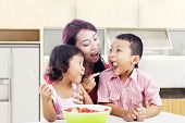 image of indian apple  - Mother and children eating healthy snack  - JPG